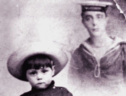 My father as small child on the left, resplendednt in sailor hat. An image of his father at the right in Merchant navy uniform..