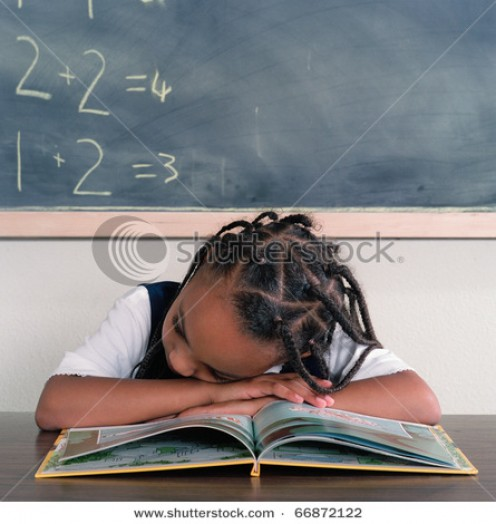 Girl Sleeping at her desk.