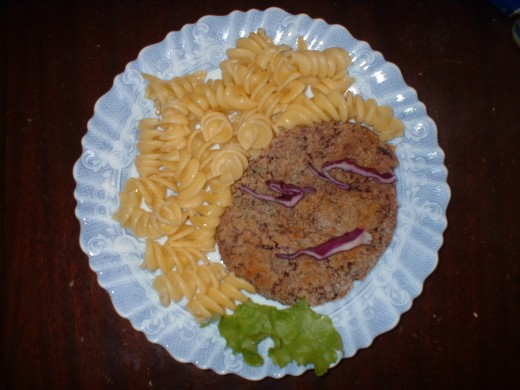 What's in your child's happy meal? This one has pasta, a bean-burger and salad (it had more salad but the picture looked better like this)