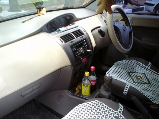 Interiors including steering, dashboard, and seats of Indica Vista Aura Quadra