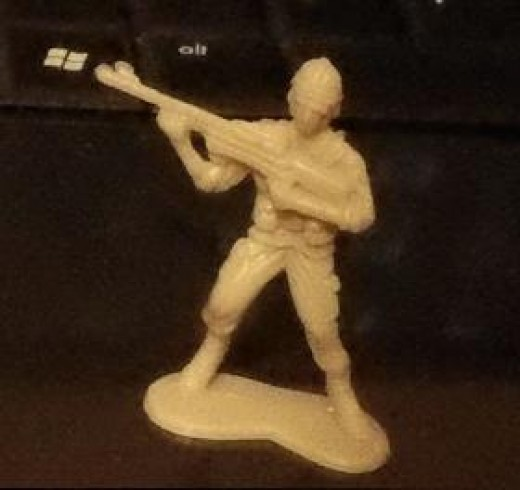 "Another Shot, Using the Sony MHS-FS1 ""Bloggie"" Camera. Toy Soldier on Keyboard in Low Light."