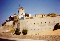 Old wall which helped fortify the City of Palma + windmill