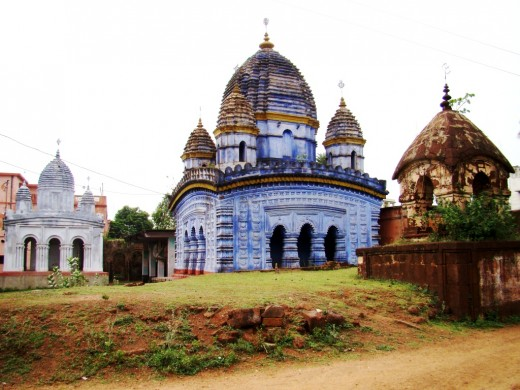 The Radha Madhav temple complex with Rasmancha on the left, the main temple in the centre & the laterite structure on the right