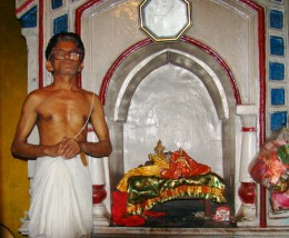 The priest with the idol of Gopal inside Gopal temple, Khandra