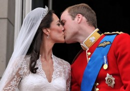 Prince William and his wife Kate, Duchess of Cambridge, kiss on the balcony of Buckingham Palace in London,Friday April 29, 2011, following their wedding at Westminster Abbey. (AP Photo/John Stillwell, Pool) (John Stillwell/AP)