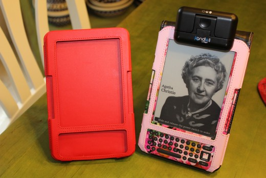 "These two are my two Kindle covers that also double as a stand. The red one is a Dura Gadget cover that is a nice ""pleather"" and the pink one is a patent leather by Tuff Luv."