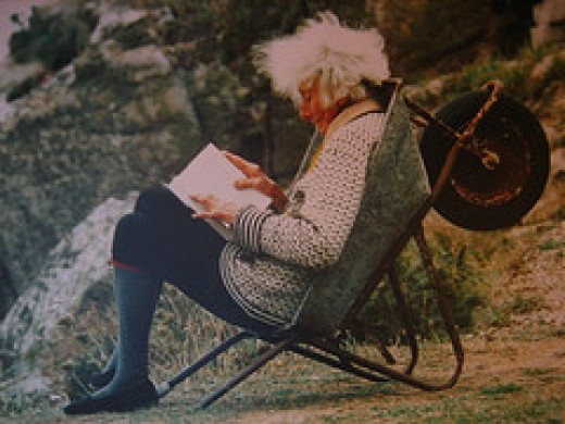 Rowena relaxing in a handy wheelbarrow - she is in her eighties here.