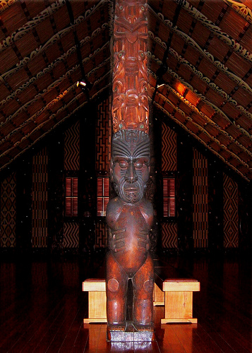 Inside Te Whare Runanga Maori meeting/community house in New Zealand at Waitangi Treaty Grounds.