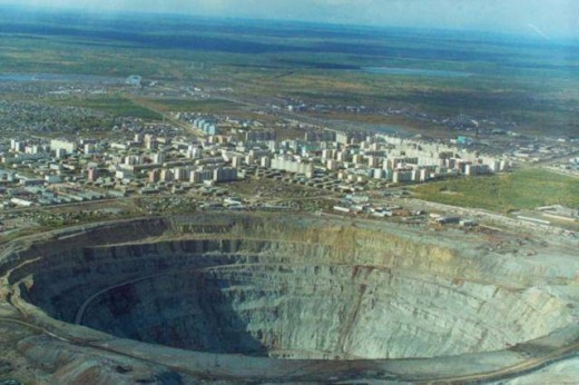 Open pit mines allow ready access to metals and minerals that are among the safest. The scars are huge and can be seen from space.