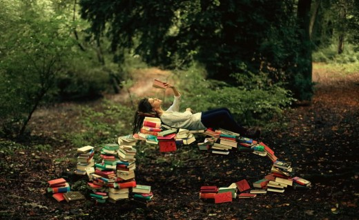 looove this picture:) I wonder how they were able to do a bridge out of books? that is just so amazing!