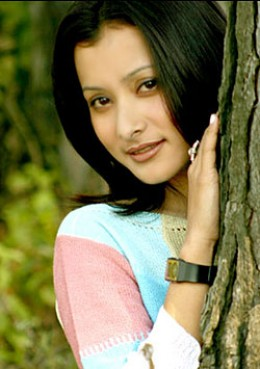 Namrata hiding behind a tree