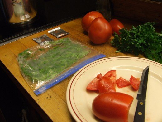 Bag of frozen parsley stems with fresh parsley  and vegetable prep.