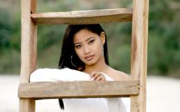 Sarah Gurung peeping through a ladder, looking beautiful
