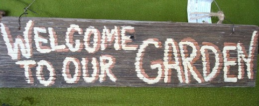 Hang a handpainted  barnwood sign by Scrappy Signs in your garden.