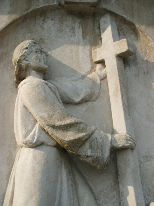Stone carving on John Bunyan's grave in Bunhill cemetery, London.