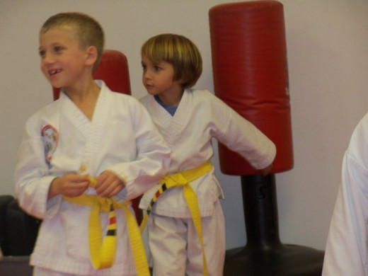 Belt systems offering stripes, as seen on these yellow belts, for the lower belts keep younger children motivated to master formation.