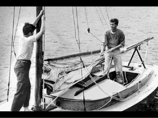 JFK hoisting the mainsail.