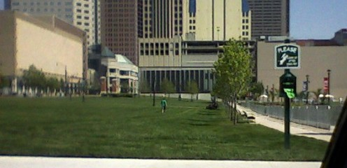 Part of the Columbus Commons undergoing a manicure on Memorial Day 2011. A line of small gardens is fenced off at the right side of this photo.