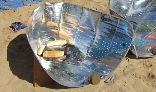 A reflector solar cooker, one of several kinds of solar ovens.