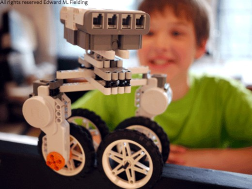 Here the focus is on the Lego NXT robot and not the young inventor. Photo: Edward M. Fielding