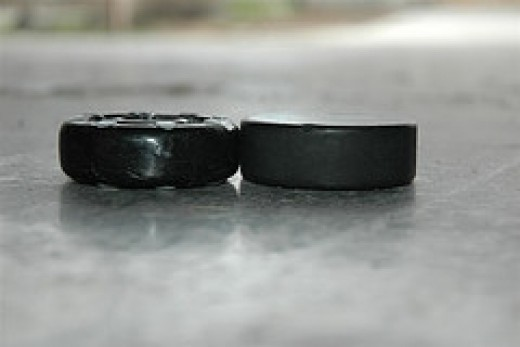 Shown here are an original puck made from a ball and the modern counterpart.