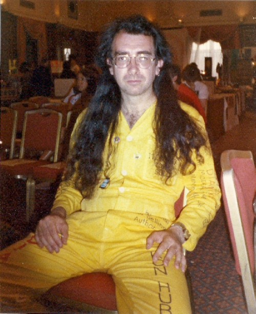Bard of Ely sporting a boiler suit he designed to promote Dianetics. Photo taken a Pyschic Fair at which Birmingham Church of Scientology had a stand.