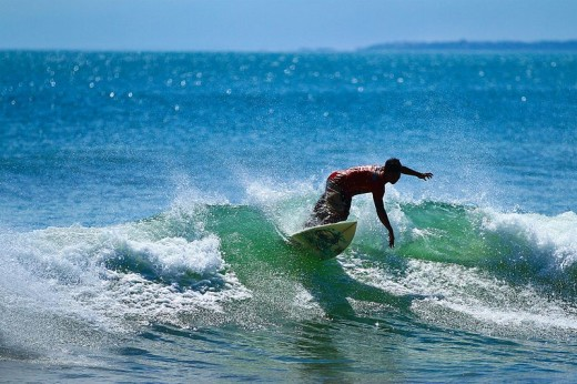 A surfer a Kuta beach