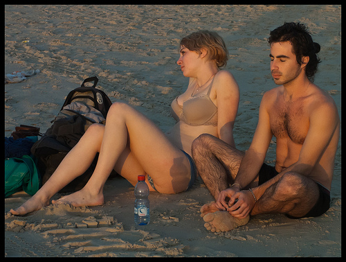 Two attractive people at the beach.