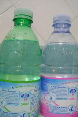 Mineral contents in both bottles are the same, except that water in the green bottle is fizzy and tasty due to higher level of carbon (IV) oxide, while that of the transparent bottle is more like normal tasteless water.