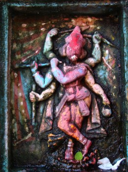One of the terracotta figures on the facade of the main temple (6-armed Krishna)