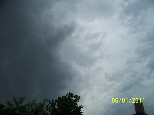 This is a picture taken of a possible cloud that could develop into a tornado, as it collides into another cloud.