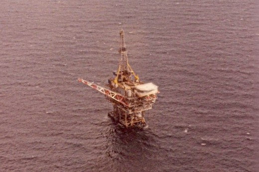 Rig off the Texas coast with Jack-up drilling rig hooked up. Notice the derrick?