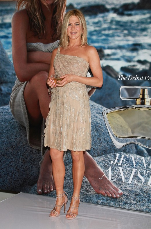 Jennifer Aniston presents her new fragrance wearing a pretty dress that shows off her gorgeous leg in high heels