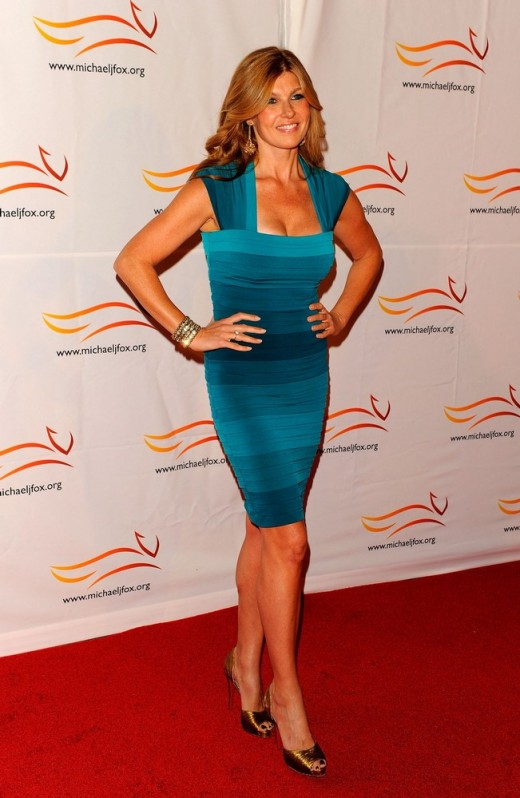 Connie Britton is sexy in a tight and low cut mini dress