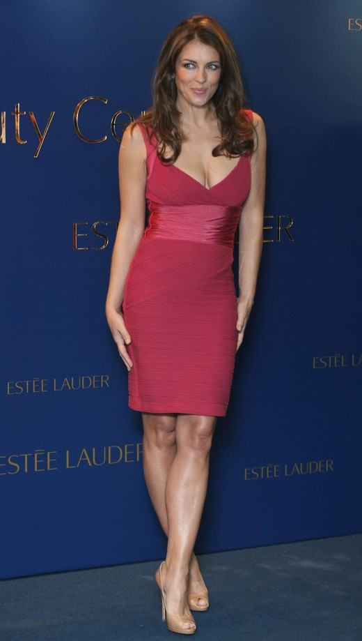Elizabeth Hurley is curvy in a tight red mini dress