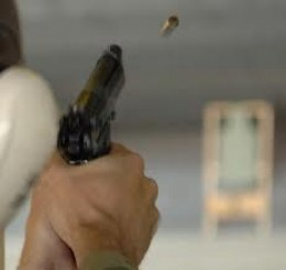 Beretta pistol ejecting empty brass during firing cycle