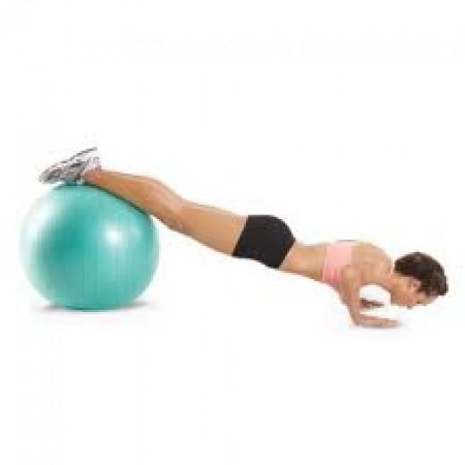 Decline stability ball pushups; feet on ball, hands on floor