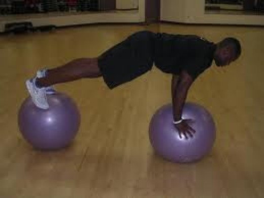 A double swiss ball pushup challenge!