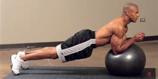 Elbow planks on stability ball. Roll elbows back and forth or extend arms from this position for a harder exercise.