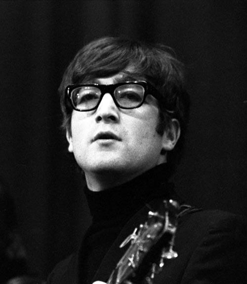 John Lennon in his Buddy Holly glasses.