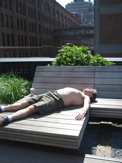 A man suns himself on the High Line in May