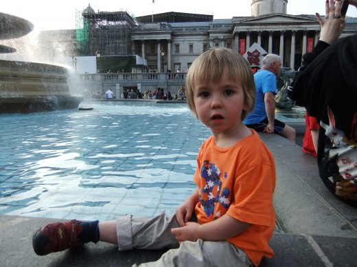 Our three year old son chilling out at Trafalgar Square