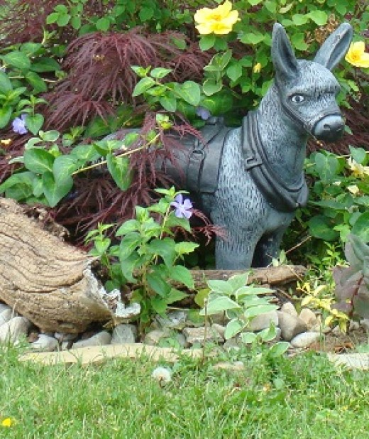 Company mascot displayed in the flower bed