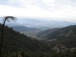 Watching the low lying plains from top cloud kissing peaks has its own charm at Dharamshala.