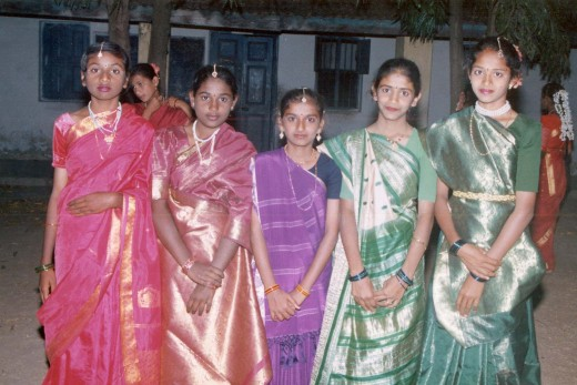 Teen age girls occassionally wear sarees. observe the varieties.