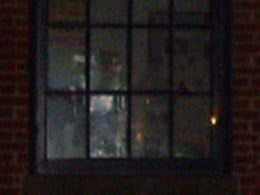 Window of historical hospital window, seems to be soldier inside