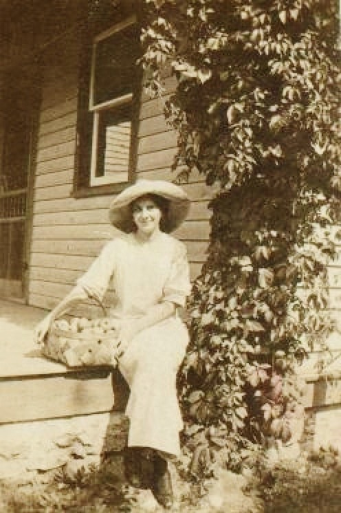 Cute photo of my grandmother with a basket full of apples.