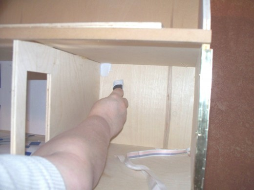 I use Kiltz to prime the raw wood or MDF.  I prime the corner with a small foam brush.