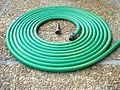 This is a green vinyl hose with a spray nasal for watering your plants and grass.