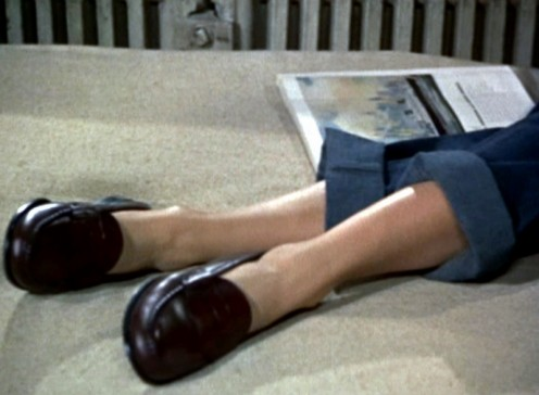 "Grace Kelly's legs, clad in denim Pedal Pushers. Still from Alfred Hitchcok's ""Rear Window"""